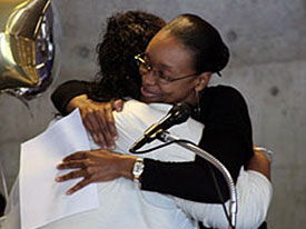 Access Counselor hugging student