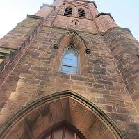 Grace Church in Providence was designed in the Gothic Revival style by Richard Upjohn and built in 1846 of New Jersey red sandstone. The sandstone formed in a rift valley more than 200 million years ago and most likely contains dinosaur footprints. Photo by E. Burns on Oct. 29, 2013.