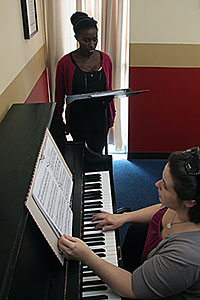 Student receives voice lessons from instructor Amanda Santo