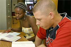 Staff working with student at the Liston Campus Writing Center